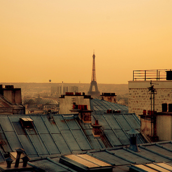 A view of the eiffel tower over paris rooftops