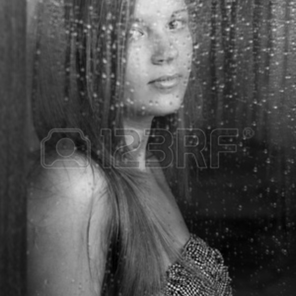 9731968 portrait of a beautiful girl and rainy window