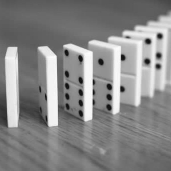 Depositphotos 185987856 stock video close view falling dominoes black