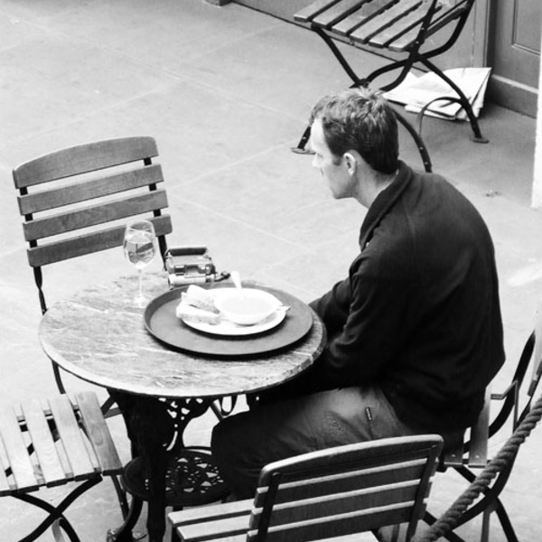 Man outside table